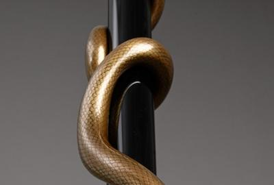 Gen Saratani, Untitled (Snake), 2018-2019 (detail).  Maki-e sculpture, maki-e technique.  Lacquer, 24 karat gold powder, whetstone powder, wire, and steel.  Overall: H.  84 x D.  5 1/2 in.  (213.4 x 14 cm).  Snake: H.  61 x D.  3 in.  (155 x 7.7 cm).  Frog: L.  3 9/16 x W.  1 3/16 x.  H.  13/16 in.  (9 x 3 x 2 cm).  Leaves: H.  5 1/2 x W.  5 1/2 in.  (14 x 14 cm).