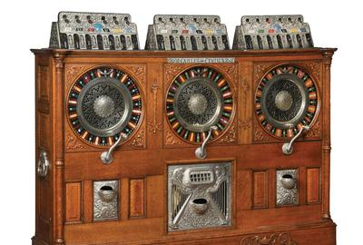 Only known example of a showstopping Caille Bros., 'Triple Centaur Jackpot' musical upright slot machine.  Accepts nickels/quarters/nickels in its three separately operating sections.  Original condition, including metal castings.  Working, with keys.  One owner since the 1970s.  Estimate $200,000-$300,000