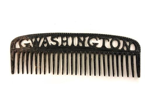 "Rare example iron comb with hollow cut lettering along the handle that reads ""G. Washington"", found in an 18th century home during a restoration project on a beam (est. $1,000-$2,000). John McInnis Auctioneers"