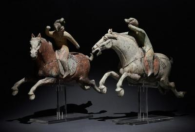 Pair of Chinese Tang Dynasty terracotta female polo players, circa 618-907 AD.  Dimensions of artworks: 420mm x 410mm.  Conveys with Ralf Kotalla (Germany) TL certificate and full report.  Estimate £6,000-£12,000