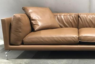 A Design Within Reach Giorgio Soressi Como sofa ($2,5/5,000) was designed by Giorgio Soressi upholstered with Kalahari leather, 90 by 42 by 30 inches deep.