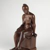 Elizabeth Catlett, Seated Woman, carved mahogany, 1962.  Sold for $389,000, a record for the artist.