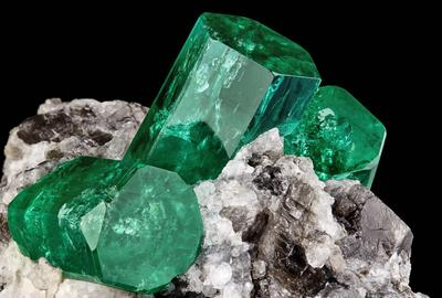 "Emerald on Calcite, ""The Three Amigos"", Coscuez Mine, Muzo Municipality, Vasquez-Yacopi Mining Dist., Boyacá Dept, Colombia.  5 cm tall x 4 cm wide.  Formerly in the Joseph Freilich & Cargill Family Collection.  Currently in the collection of Mr.  Irv Brown.  Photography by Evan D'Arpino."