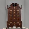 The Samuel Gardner Important Queen Anne Walnut and Walnut-Veneered Bonnet Top Highboy; Salem, MA; ca.  1740; Estimate: $50,000-100,000