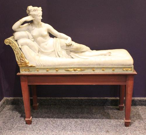 Carved marble sculpture of Pauline Bonaparte as Venus Victrix, from the 19th or 20th century after Antonio Canova (Italian, 1757-1822) on a custom-built wood stand (minimum bid: $3,500). Nye & Company Auctioneers