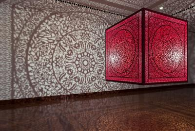 Anila Quayyum Agha (b.  1965), All the Flowers Are for Me (Red), laser-cut lacquered steel and lightbulb, 60x60x60 in, Alice Bimel Endowment for Asian Art, 2017.7