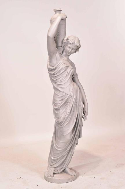 """Late 19th century French painted cast-iron figure of a woman with an urn, labeled """"Val d'Osne"""", 52 inches tall (minimum bid: $400). Nye & Company Auctioneers"""