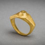 A massive Imperial Roman solid gold ring of angular wide shouldered style, a raised circular boss on the bezel.  Intact, 3d - 4th Centuries AD, eastern Mediterranean.