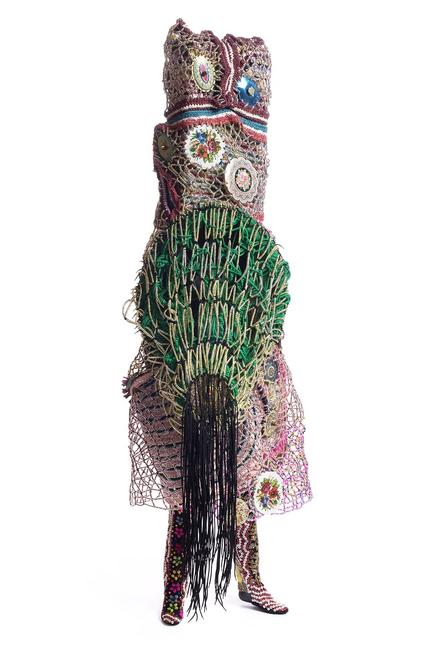 Nick Cave, Soundsuit, 2015.  Mixed media, including enameled can lids, macramé, shoelaces, plastic beads, metal, and mannequin, 99 x 37 x 36 in.  (251.5 x 94 x 91.4 cm).  Courtesy of the artist and Jack Shainman Gallery, New York.