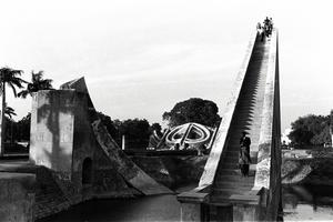 Photograph by Isamu Noguchi of Samrat Yantra (foreground) and Mishra Yantra (background) at the Jantar Mantar observatory, Delhi, India, 1949.  © Isamu Noguchi Foundation and Garden Museum.