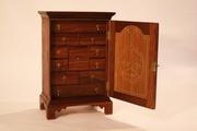Title: Spice Cabinet Artist: Chris Anderson, CF '12 Materials: walnut, holly, black locust, red cedar