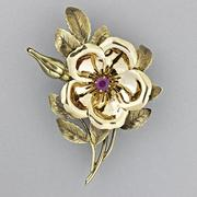 Tiffany & Co.  Bicolor Gold Ruby Brooch, $2,000-3,000