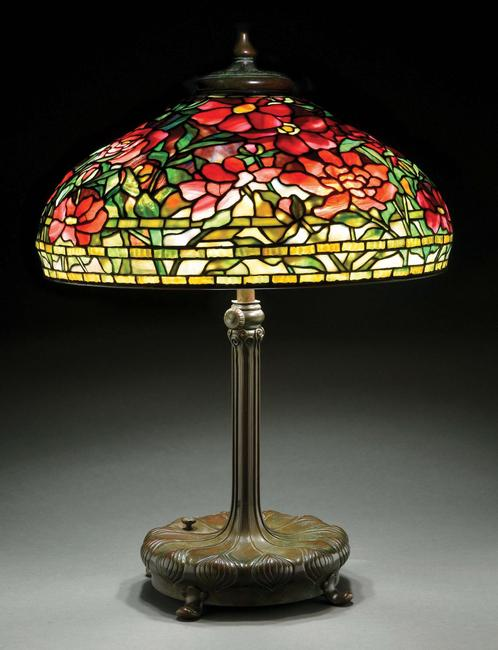 Circa-1910 Tiffany Studios 'Peony' leaded-glass table lamp, both 22in shade and telescopic, six-socket 'Chased Pod' base are signed.  Excellent condition.  Estimate $100,000-$150,000