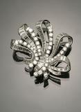 Pair of Platinum and Diamond Bow-Knot Clips, Mounted as Brooch