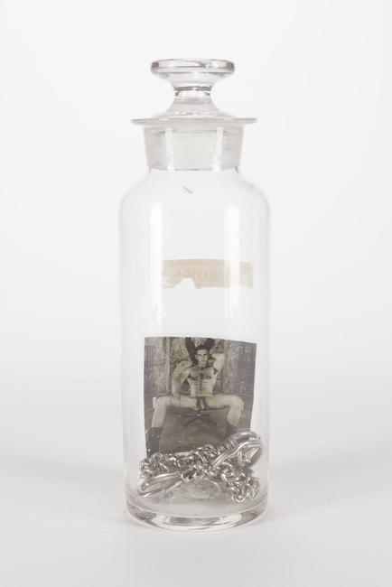 Boys in a Bottle: Poison, Assemblage with found objects and photograph, 8 3/8 x 3 x 3 inches.