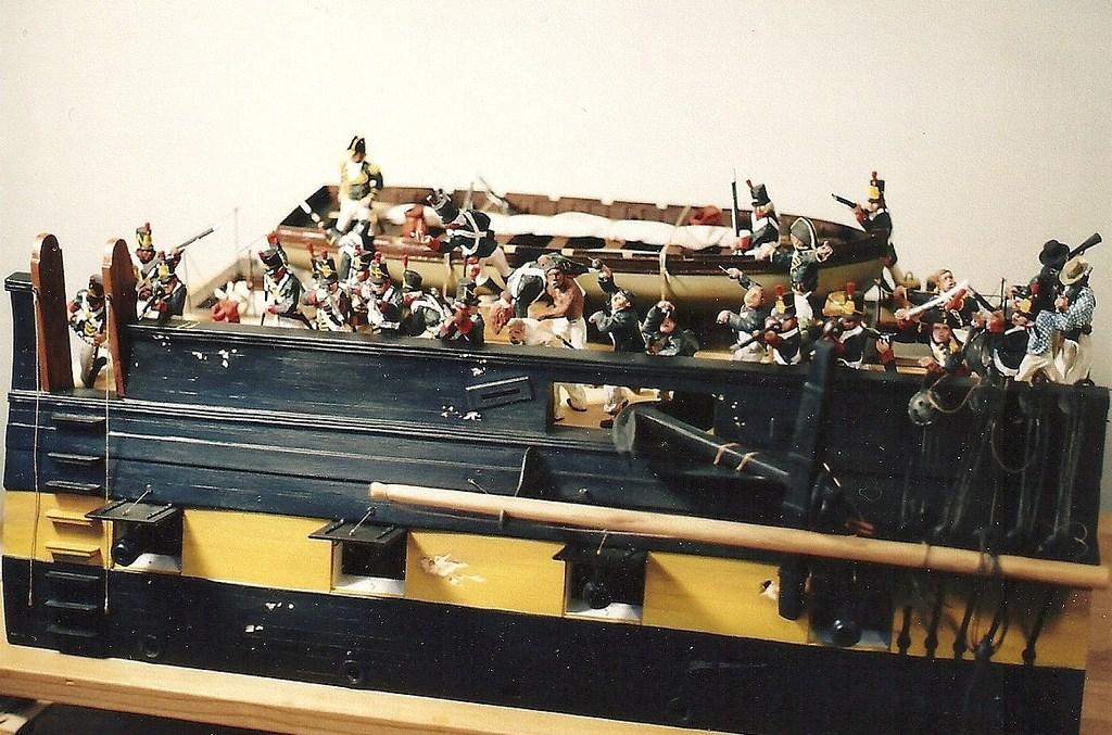 Woodsculpted cutaway showing action on both decks with the feature of 70 handcarved wood figurines.