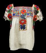 China poblana blouse, c.  1935 Puebla city and state, México Cotton, glass beads, 24 ½ x 21 1/16 in.  (62.25 x 53.5 cm.) Gift of Florence Dibell Bartlett, Museum of International Folk Art, A.1955.1.135 Photograph by Addison Doty