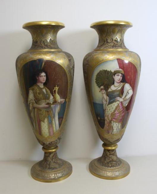 Lot 203 is the magnificent pair of artist signed vases