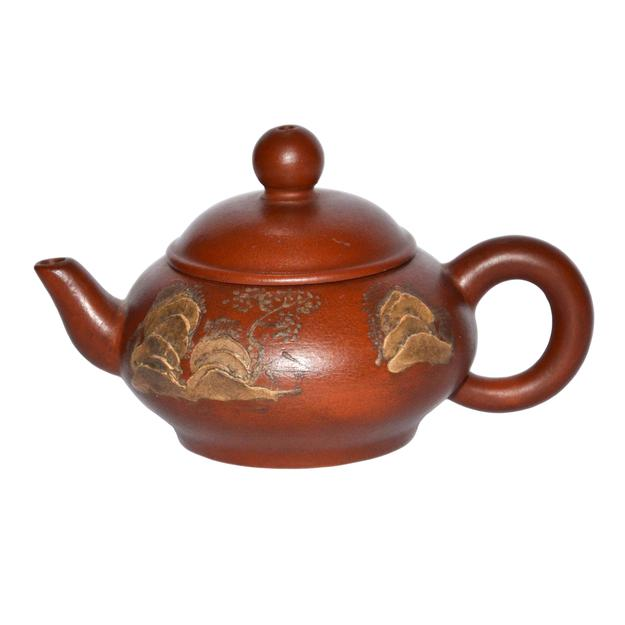 One of two mountainous landscape Zisha teapots by Ming master Hui Meng Chen's in Gianguan Auctions December 9, 2017 sale.
