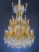 This monumental chandelier is saturated with oversized, luminous prisms and beads of fine Baccarat crystal