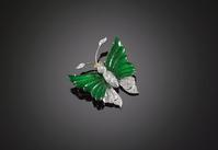 The jadeite in this butterfly brooch exhibits the telltale translucent emerald green color for which this stone is so highly desired.