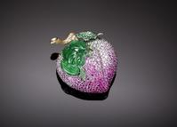 This exceptional brooch incorporates precious Imperial jadeite, sapphires and tsavorite garnets