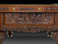Australia's Aboriginal roots are depicted in the magnificent high-relief carving that covers this table