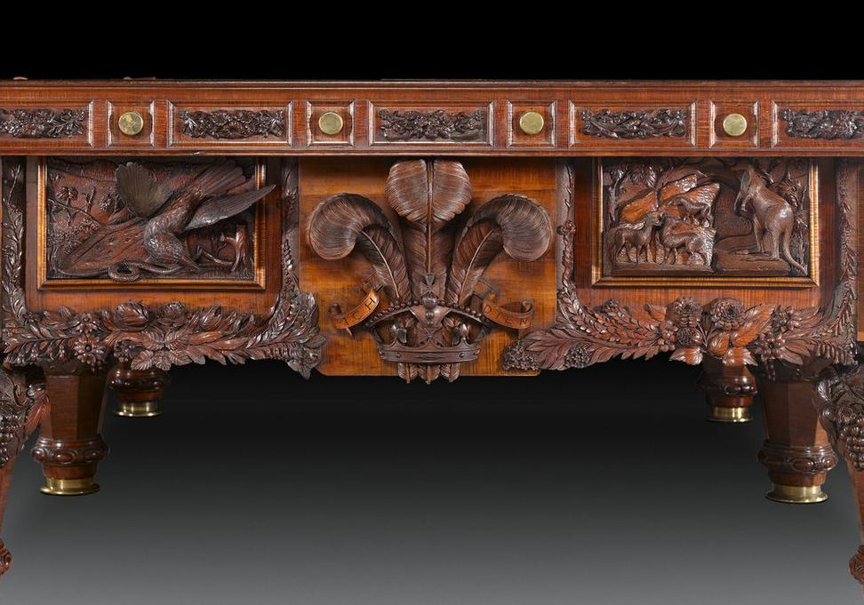 The Prince of Wales' symbolism denote this historic table's royal provenance