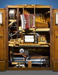 This early model features stand-alone instruments, including drums, an organ, a triangle and a piano accordion