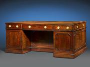 This incredibly rare pedestal desk bears numerous characteristics that suggest its creation by Thomas Chippendale himself.
