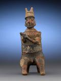 This incredible Nayarit Warrior Figure represents a highly respected chieftain, as indicated by the horns, staff and seated posture.