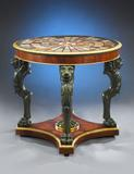 Superb Regency period rosewood specimen center table bearing an astounding 128 samples of rare marble from around the world.  Held aloft by four majestic verdigris-painted lion monopodia, the tabletop is beautifully edged in gilded gadrooning and set upon a raised plinth base.  Rich in Neoclassical elegance yet possessing an exotic worldliness, specimen tables such as this were extremely popular with members of the British aristocracy during the early 19th century.