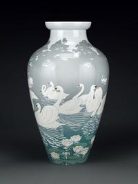 A motif of sensuous swans executed in a style illustrating the influences of the Art Nouveau and Japonisme surrounds each magnificent vase.