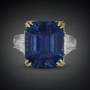 Immense rarity and beauty define this awe-inspiring untreated 18.50-carat Kashmir sapphire.  This emerald-cut natural wonder is accompanied by 1.30 carats of diamonds and set in platinum and 22K yellow gold.