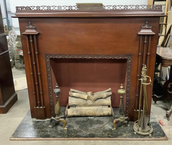 This RCA Victor fireplace radio ($500-1,500) comes with a set of fireplace tools and accessories.  It measures 50 by 60 by 25 inches.
