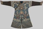 BLUE SILK METALLIC THREAD EMBROIDERED NINE DRAGON ROBE, early 19th century; decorated with conch shells, lotus flowers, fish, sacred vases, tasseled canopy, and other sacred symbols and motifs; estimate: $6,000-10,000