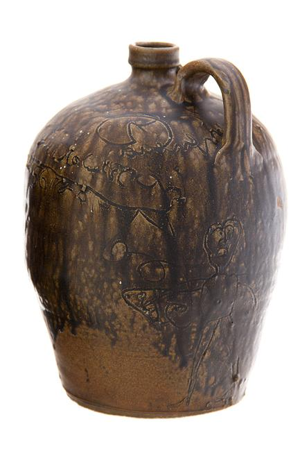 Lot 500, an important Southern Edgefield District stoneware pictorial jug attributed to Stoney Bluff, possibly Dave, estimated at $40,000-$70,000.