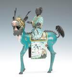 Lot 1306.  Cloisonne Figural of Quan Yin Riding a Qilin.  est $3,000-$5,000
