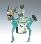 Lot 1306.  Cloisonne Figural of Quan Yin Riding a Qilin.  est $3,000-$5,000