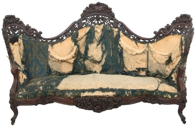 "A J.H.  Belter ""Fountain Elms"" pattern pierced carved laminated rosewood Rococo sofa ($20/30,000) has elaborate carved crests with flowers, fruit, filigree and cornucopias over the serpentine S-scroll framework, 49½ by 88½ by 32 inches."