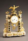 Louis XVI Ormolu Mounted Marble and Slate Mantel Clock ($7,000-$9,000)