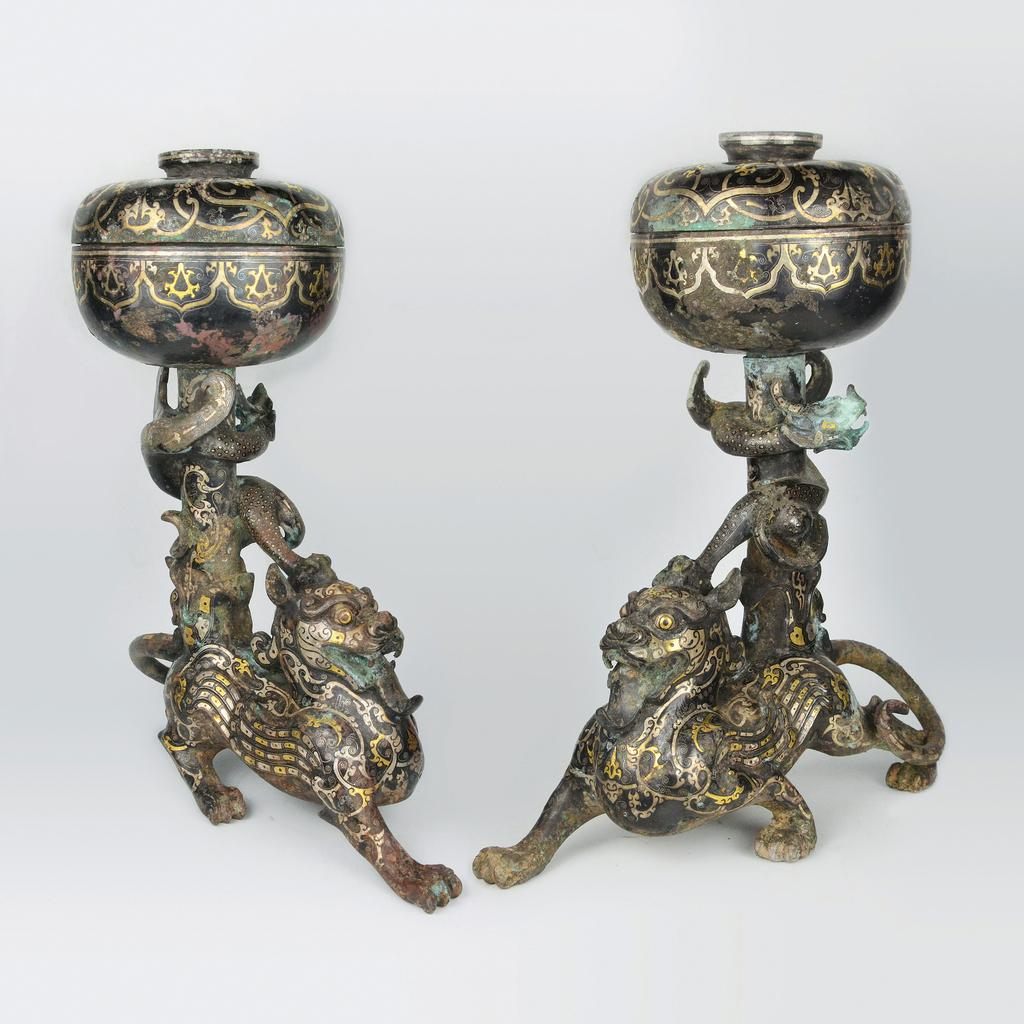 Warring Stated Dou on Bixie.  Bronze with silver and gold inlaid geometrics and scrolls.  Gianguan Auctions.  September 8th, 2018 sale.