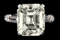 Impressive 9.90 carat Platinum and Diamond Ring, centering on one emerald cut diamond (est.  $80,000-$100,000)