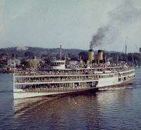 Photo show steamboat ALEXANDER HAMILTON approaching Day Line dock at Albany, New York c.1959.