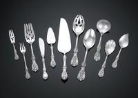 The stunning Reed & Barton flatware is crafted in the resplendent Francis I pattern