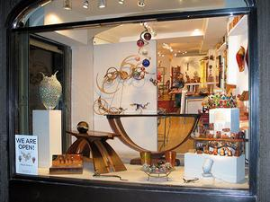 An American Craftsman Galleries' window at the new location: 217 East 60th Street, NYC