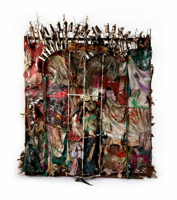 Thornton Dial (American, 1928-2016).  History Refused to Die, 2004.  Okra stalks and roots, clothing, collaged drawings, tin, wire, steel, Masonite, steel chain, enamel, spray paint, 8 ft.  6 in.  x 87 in.  x 23 in.  (259.1 x 221 x 58.4 cm).  The Metropolitan Museum of Art, New York, Gift of Souls Grown Deep Foundation from the William S.  Arnett Collection, 2014.  © Thornton Dial