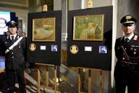 Carabinieri (Italian paramilitary police) officers flank the recovered artworks by Gauguin and Bonnard at a press conference in Rome on April 2, 2014.