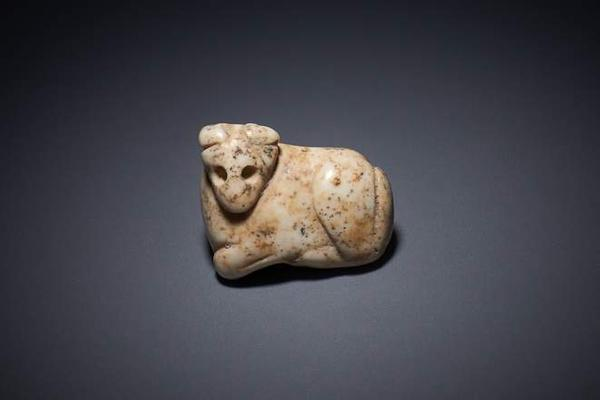 This white marble amulet is believed to have been crafted during the Jemdet Nasr period around 3000 BC