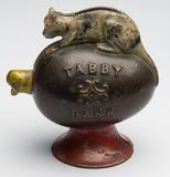 "Tabby cast iron mechanical bank, embossed ""Tabby Bank"" with nodding chick, original paint.  J.  & E.  Stevens & Co.  Fourth quarter 19th century.  Sold for $5,750 against $300-500 estimate."